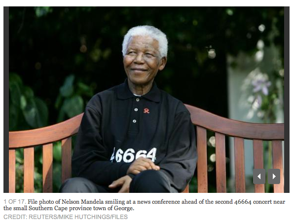 "Mandela smiling  a ""Giant for Justice"""