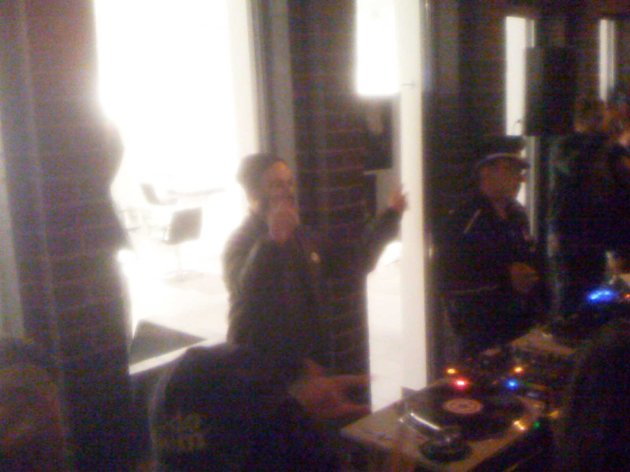 dj gesticulating and dancing as agitated policeman waits